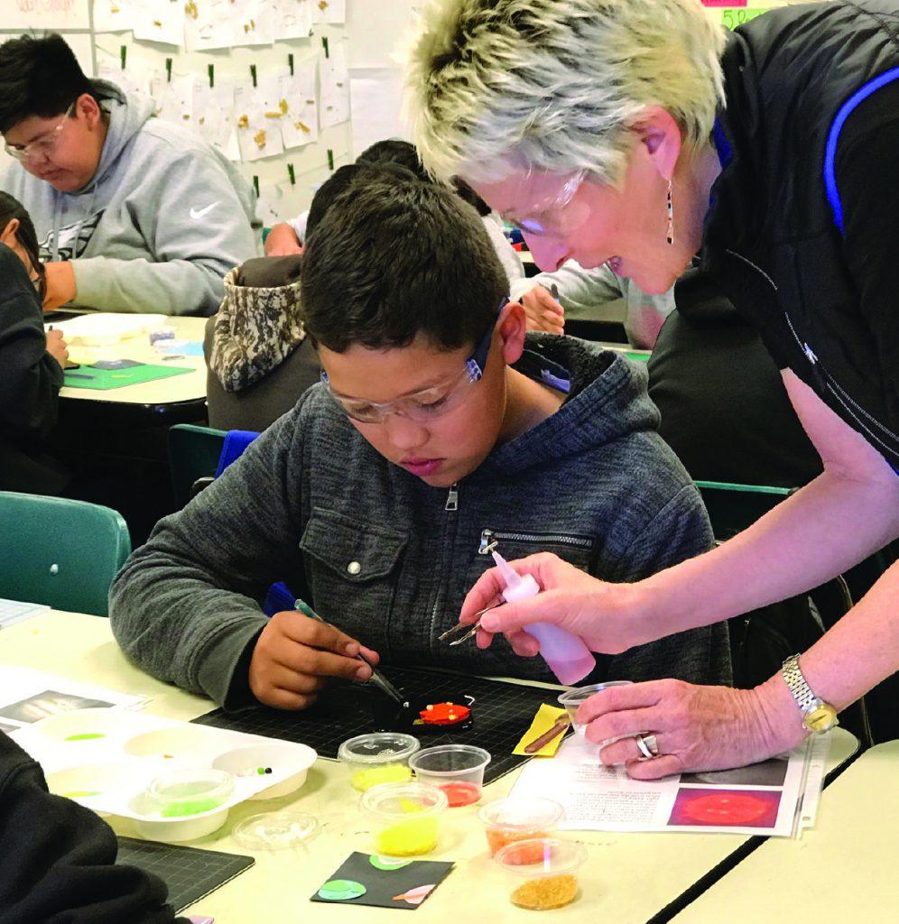 Artist Connie Trenholm working with Montezuma Creek Elementary students.