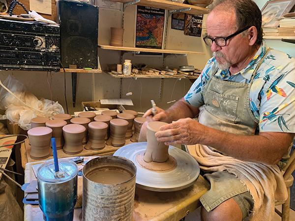 Potter Joe Bennion at the wheel shaping a stacked pot